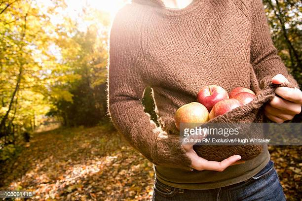 Woman carrying apples
