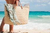 Woman carrying beach bag, Mustique, Grenadine Islands