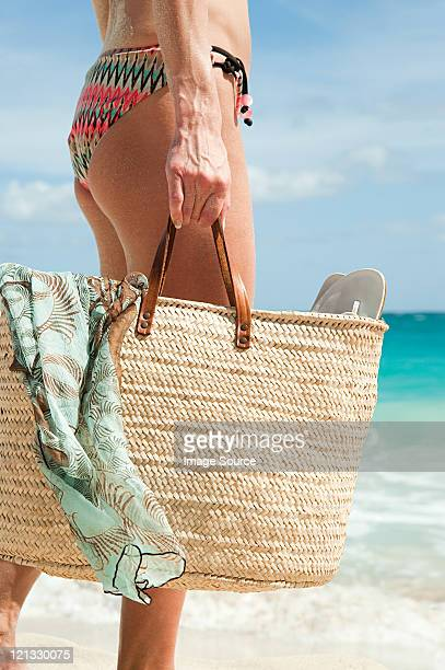 Woman carrying beach bag, Mustique, Grenadine Islands