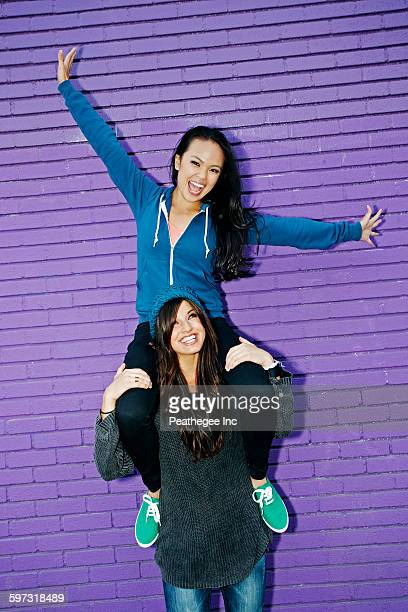 Woman carrying friend on shoulders
