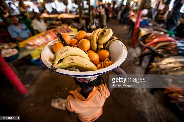 Woman carrying fruitbowl on her head