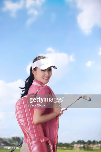 Woman Carrying Golf Bag Stock Photo Getty Images