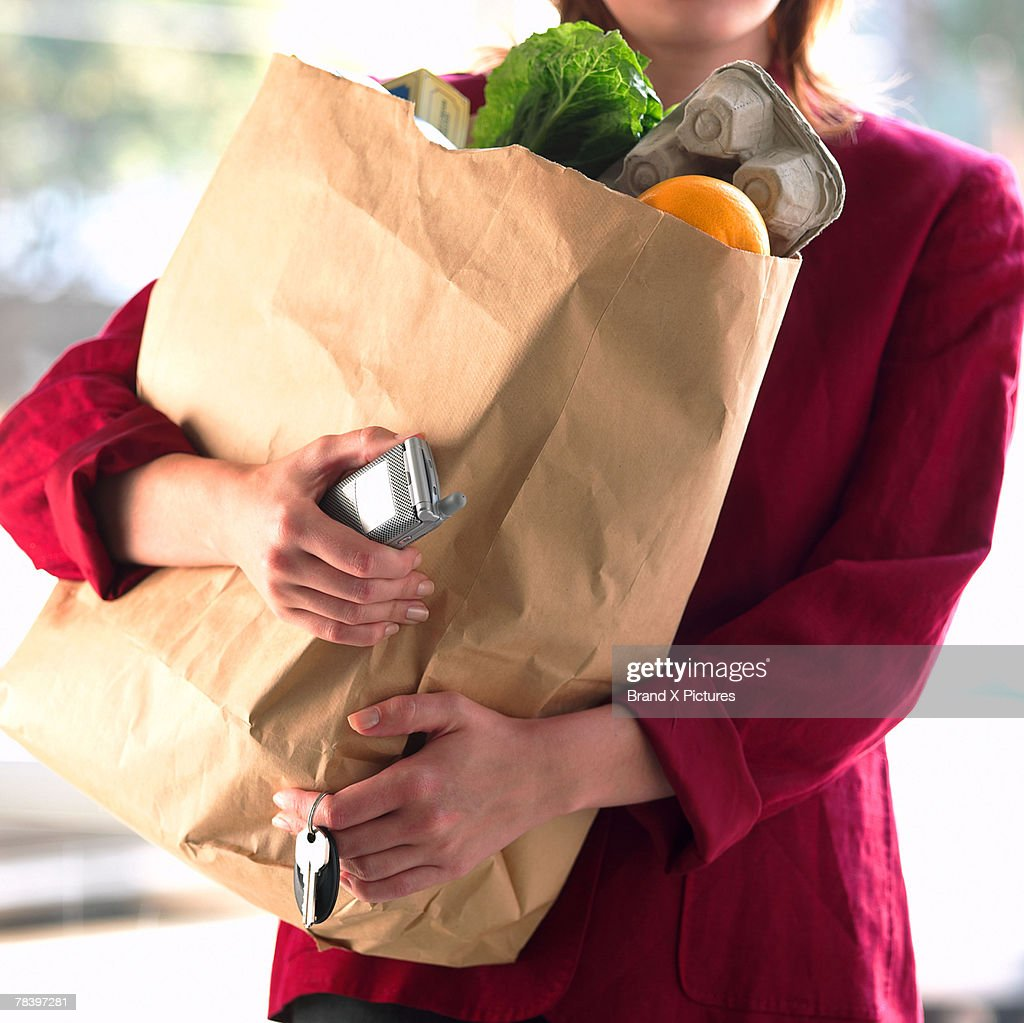 Woman carrying groceries
