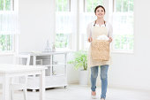 Woman Carrying Laundry Basket