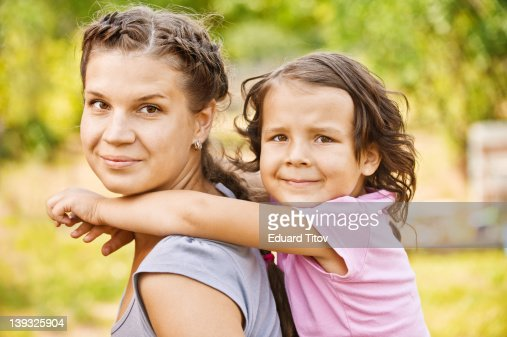 Woman carrying little girl : Stock Photo