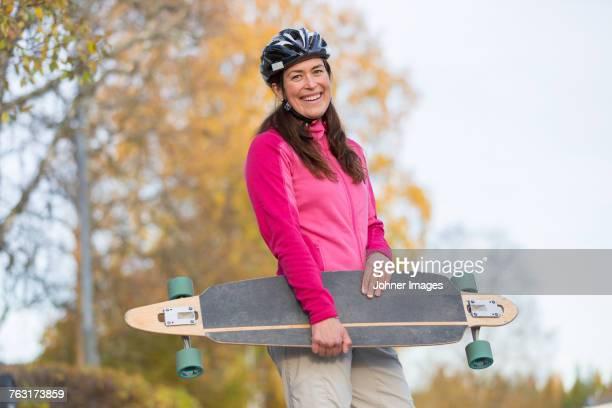 Woman carrying longboard