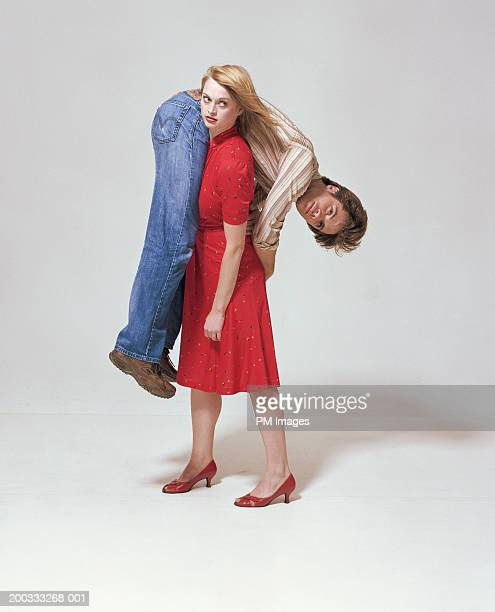 Woman carrying man on shoulder