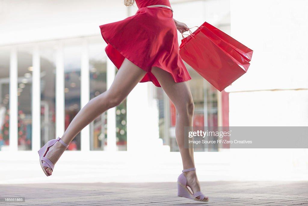 Woman carrying shopping bag outdoors : Stock Photo