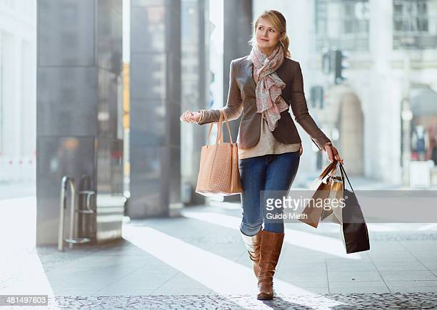Woman carrying shopping bags.