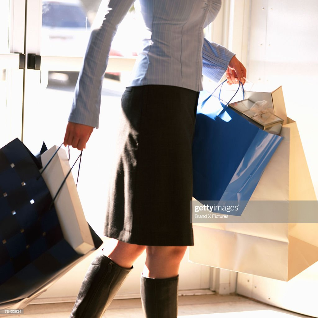 Woman carrying shopping bags : Stock Photo
