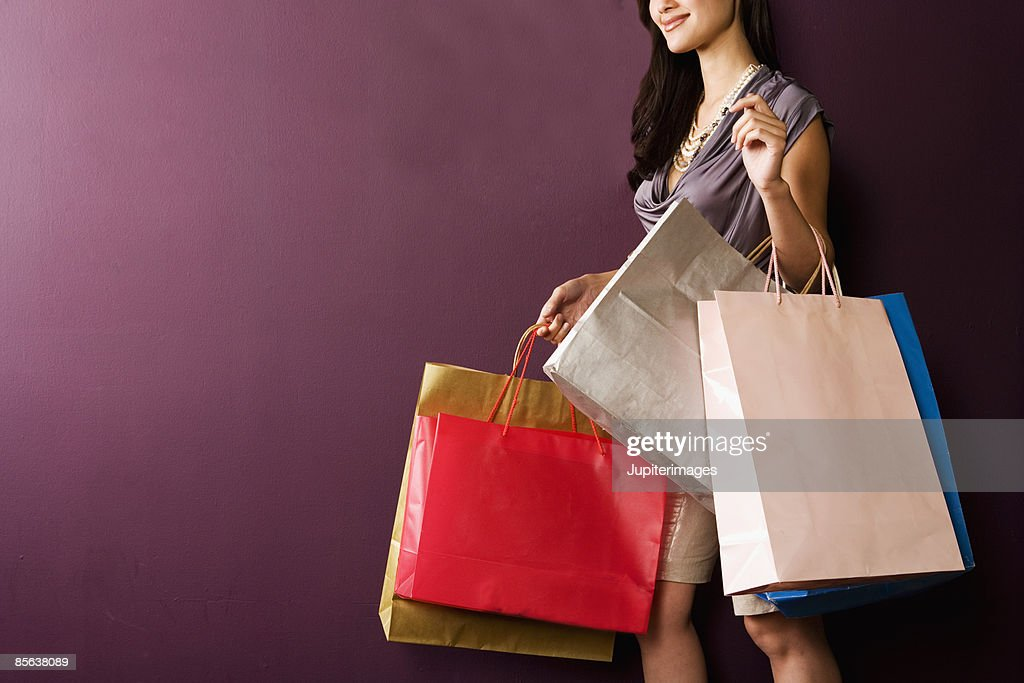 Woman carrying shopping bags : Stock Photo