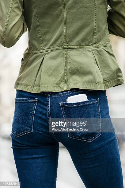 Woman carrying smartphone in back pocket