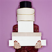 Woman carrying tall stack of boxes