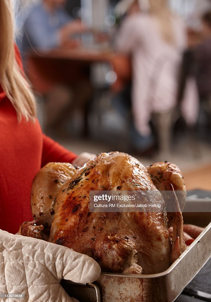 Woman carrying Thanksgiving turkey