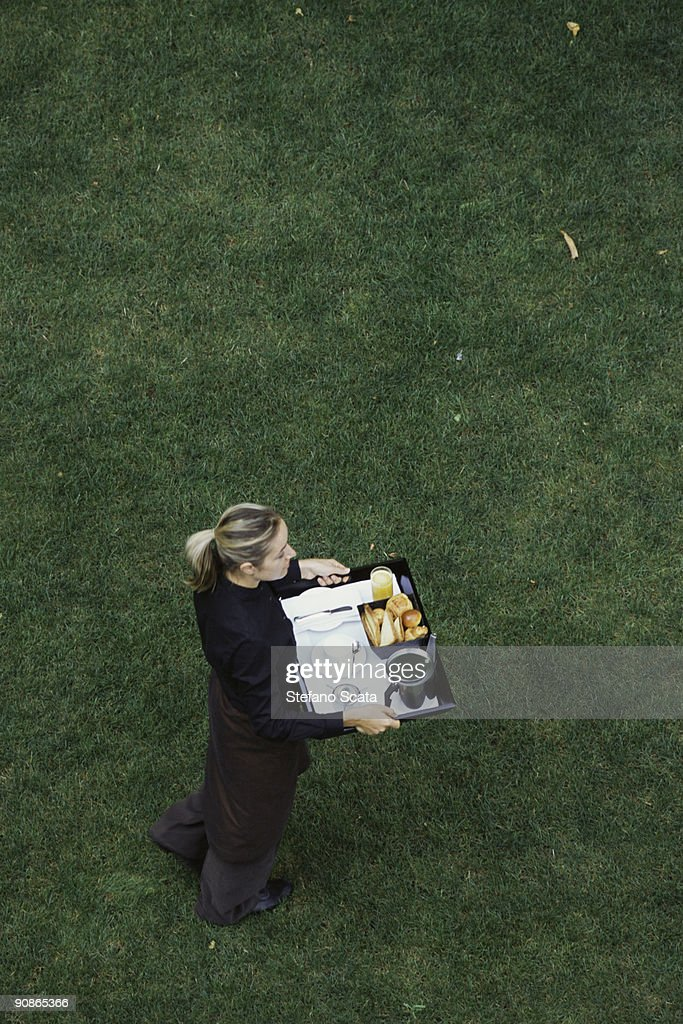 Woman carrying tray : Stock Photo