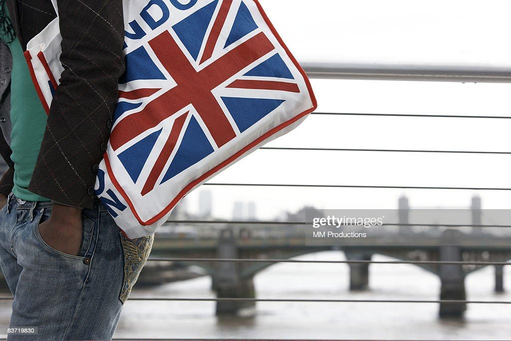Woman carrying Union Jack bag : Stock Photo