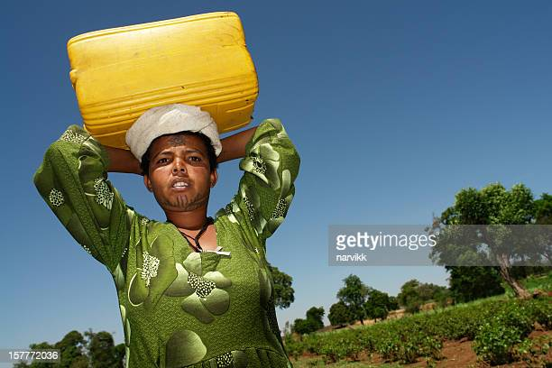 Woman Carrying Water Canister
