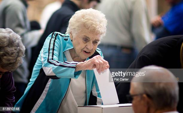 A woman cast her ballot for a presidential candidate during the state's Republican caucus on March 5 2016 in Wichita Kansas People were standing in...