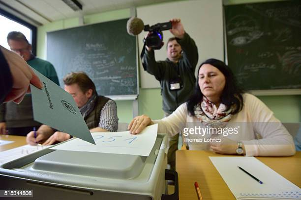 A woman castes her ballot in RhinelandPalatinate state elections on March 13 2016 in Bad Kreuznach Germany State elections taking place today in...