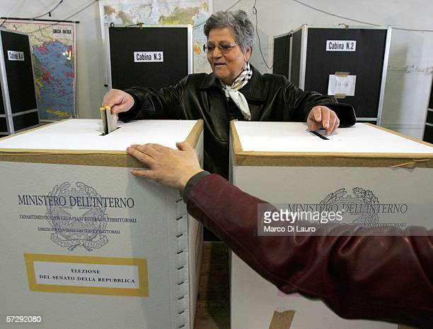 A woman casts her ballot at a polling station April 9 2006 in Rome Italy About 47 million Italians are eligible to vote on April 9 and April 10 to...