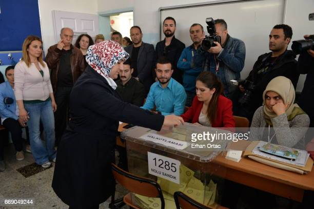 A woman casts her ballot at a polling station during a referendum in Ankara April 16 2017 Turkey Millions of Turks are heading to the polls to vote...