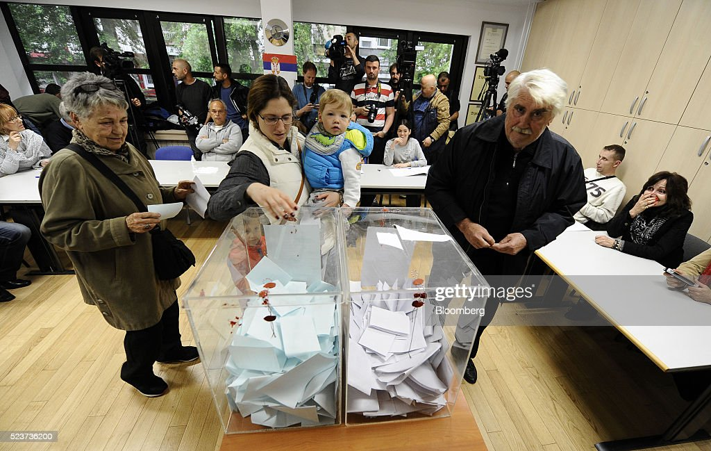A woman casts her ballot at a polling station during general elections in Belgrade, Serbia, on Sunday, April 24, 2016. Serbians headed to the polls in snap elections called by Prime Minister Aleksandar Vucic, whos seeking another four years in power to overhaul the economy and lead the country closer to joining the European Union. Photographer: Oliver Bunic/Bloomberg via Getty Images News