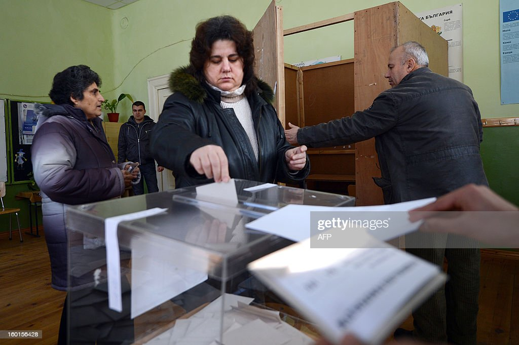 A woman casts her ballot at a polling station during the national referendum in the town of Belene on January 27, 2013. Bulgarians voted Sunday on whether to revive plans ditched by the government to construct a second nuclear power plant, in the EU member's first referendum since communism. The referendum asks 6.9 million eligible voters: 'Should Bulgaria develop nuclear energy by constructing a new nuclear power plant ?'. AFP PHOTO / DIMITAR DILKOFF