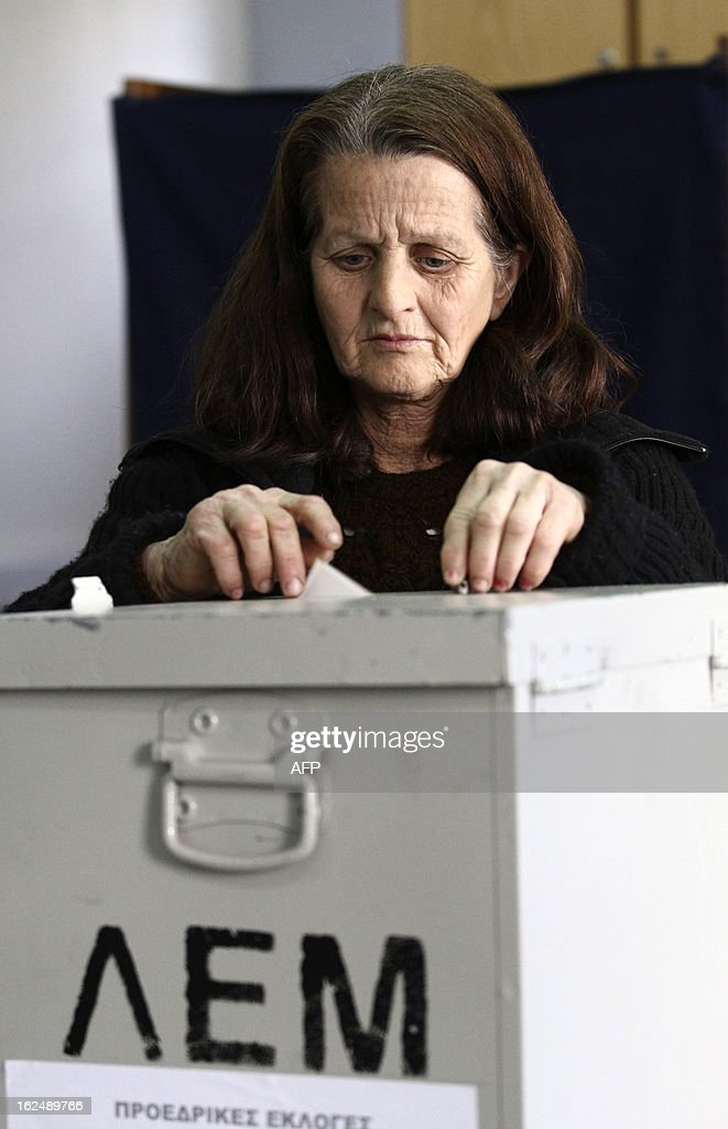 A woman casts her ballot at a polling station during the second round of the Cyprus' presidential election on February 24, 2013 in Limassol. Cypriots began voting in a crucial left-right presidential runoff to elect a new leader to seal a much needed rescue package for the EU state on the brink of financial ruin.