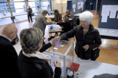 A woman casts her ballot at a polling station during the second round of a local byelection on October 13 2013 in Brignoles southern France French...
