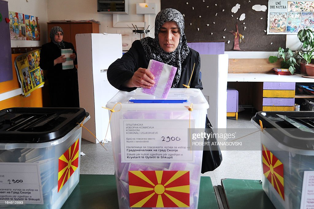 A woman casts her ballot at a polling station in Skopje on March 24, 2013, as part of the local elections held against a backdrop of ethnic tensions, as a political crisis between the right-wing government majority and left-wing opposition rumbles on. AFP PHOTO / ROBERT ATANASOVSKI