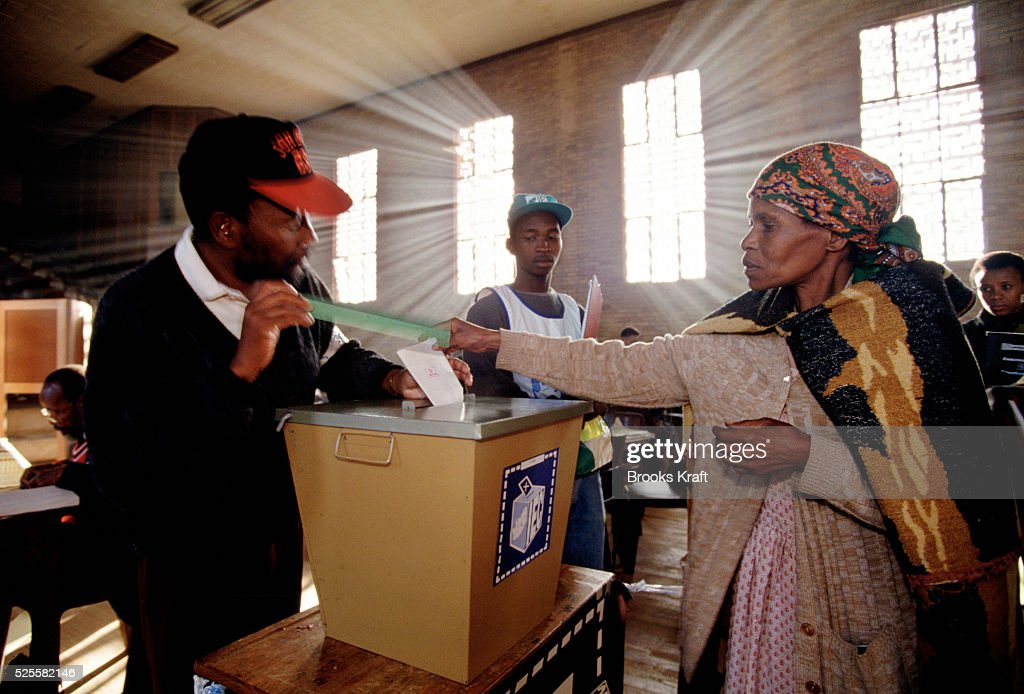 A woman casts her ballot at a polling station in Soweto Millions of South Africans voted in the nation's first free and democratic general election...