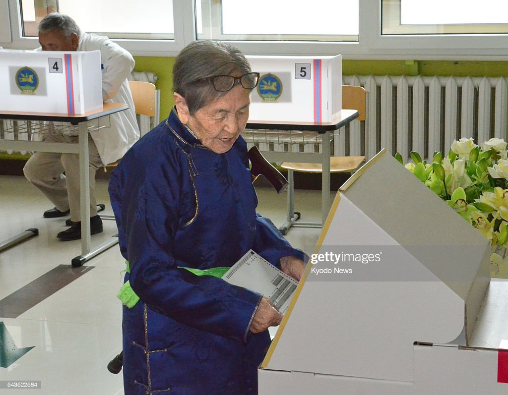 A woman casts her ballot at a polling station in Ulan Bator on June 29, 2016, in Mongolia's general election.