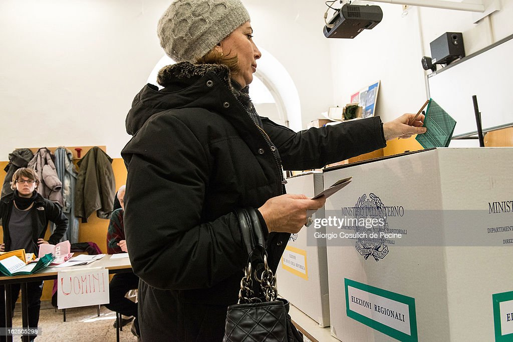 A woman casts her ballot at a polling station on February 24, 2013 in Rome, Italy. Italians are heading to the polls today to vote in the elections, as the country remains in the grip of economic problems . Pier Luigi Bersani's centre-left alliance is believed to be a few points ahead of the centre-right bloc led by ex-Prime Minister Silvio Berlusconi.
