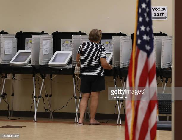 A woman casts her ballot during a special election in Georgia's 6th Congressional District special election at North Fulton Government Service Center...