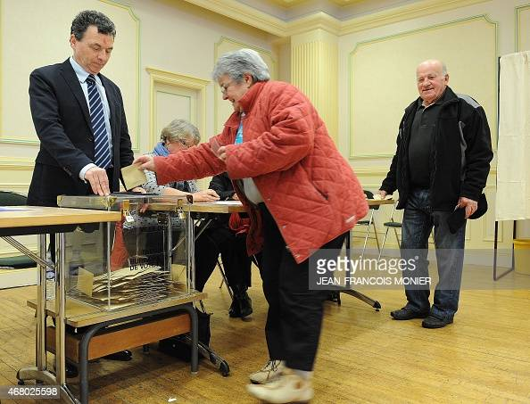 A woman casts her ballot during the second round of French departementales regional elections on March 29 2015 in the town hall of Plerin western...