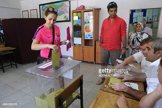 A woman casts her ballot for Turkey's presidential election at a polling station in Ankara on August 10 2014 Polling stations across Turkey opened on...