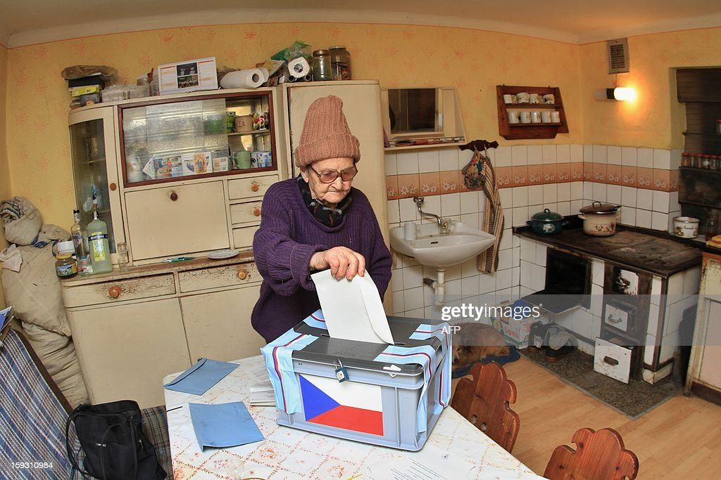 A woman casts her ballot in a house, taking part in the first Czech direct presidential election on January 11, 2013 in Lopenik, Czech. Members of the electoral commission visit people who live in houses remote. Czech polling stations opened on January 11 afternoon in local mid-time for the first round of the first Czech direct presidential election in history.