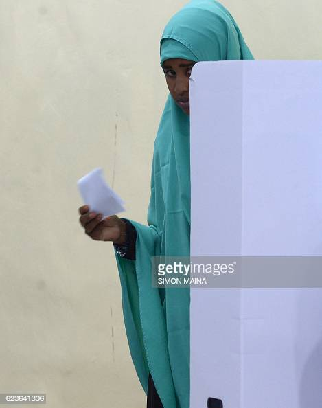 TOPSHOT A woman casts her ballot on November 16 in Baidoa Somalia is in the process of selecting a new parliament upper house and president in a...