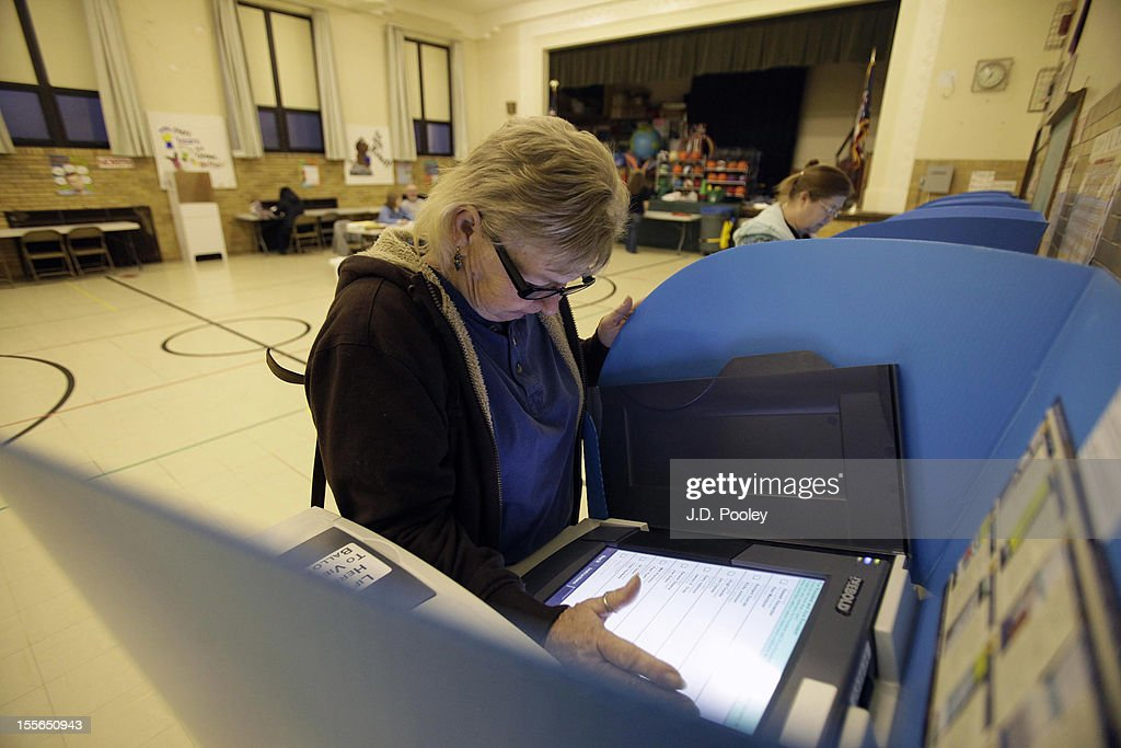 A woman casts her ballot using an electronic voting machine at an elementary school on November 6, 2012 in Bowling Green, Ohio. Voting is underway in the US presidential election in the battleground state of Ohio. Recent polls show that U.S. President Barack Obama and Republican presidential candidate Mitt Romney are in a tight race.