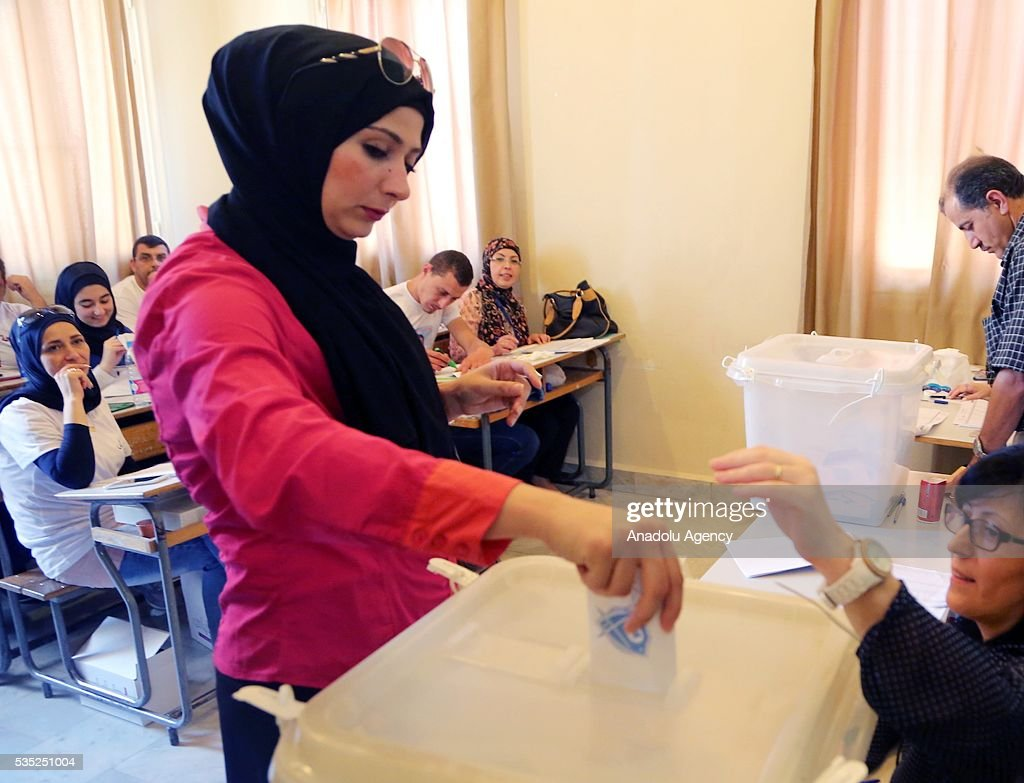 A woman casts her vote at a polling station during the Lebanese Local elections in Tripoli, Lebanon on May 29, 2016.