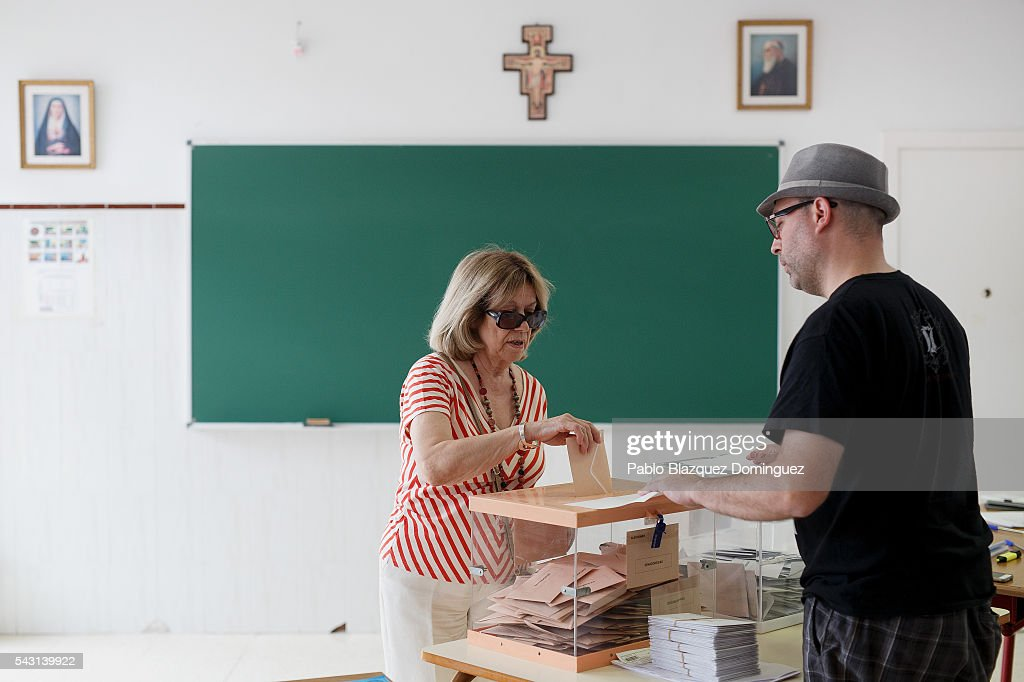 A woman casts her vote at a polling station during the Spanish General Elections on June 26, 2016 in Madrid, Spain. Spanish voters head back to the polls after the last election in December failed to produce a government. Latest opinion polls suggest the Unidos Podemos left-wing alliance could make enough gains to come in second behind the ruling center right Popular Party.