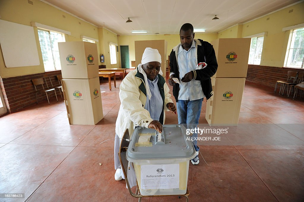 A woman casts her vote at a polling station in Chitungwiza, on March 16, 2013, as voting kicked off for Zimbabwean referendum for a new constitution designed to underpin democratic reforms.