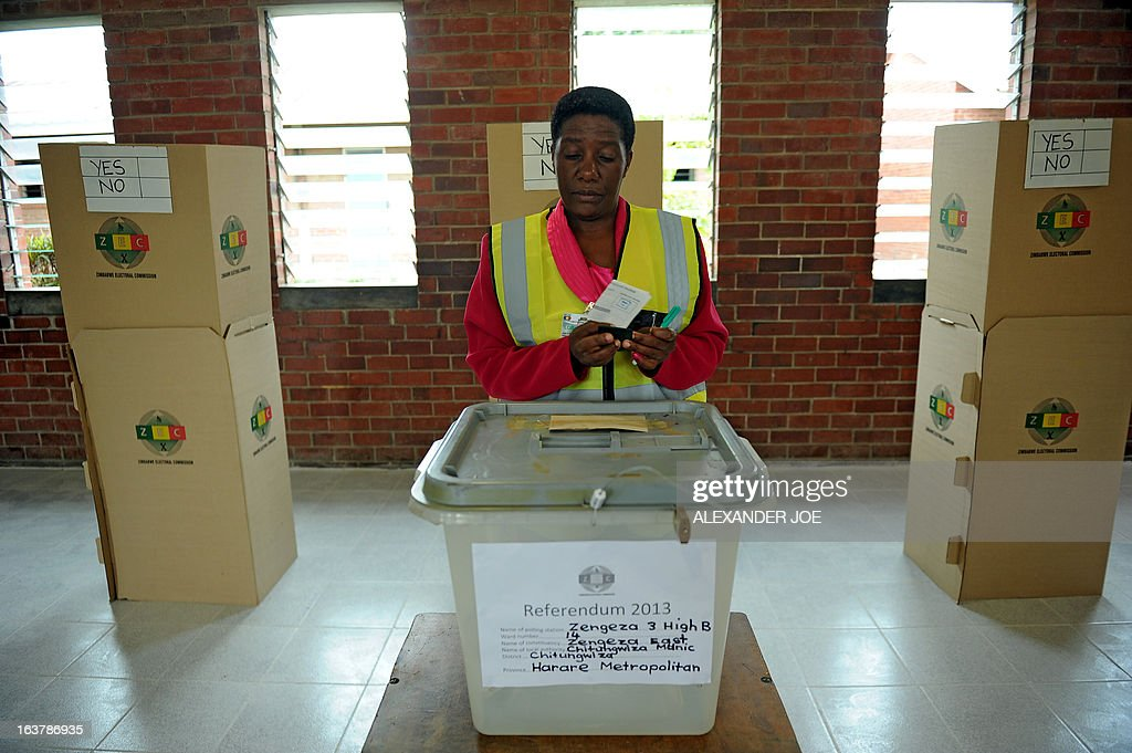 A woman casts her vote at a polling station in Chitungwiza, on March 16, 2013, as voting kicked off for Zimbabwean referendum for a new constitution designed to underpin democratic reforms. AFP PHOTO / ALEXANDER JOE