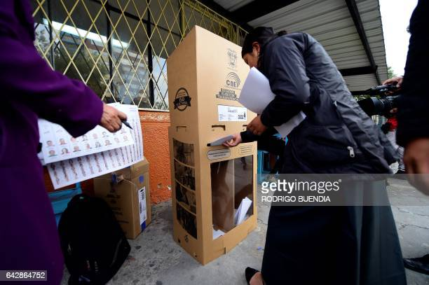 A woman casts her vote at a polling station in Quito on February 19 2017 during general elections Ecuador's elections will decide who succeeds...