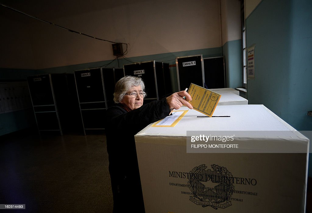 A woman casts her vote at a polling station in Rome on February 24,2013, as part of Italy's general elections. Italians fed up with austerity voted on Sunday in the country's most important election in a generation, as Europe held its breath for signs of fresh instability in the eurozone's third economy.