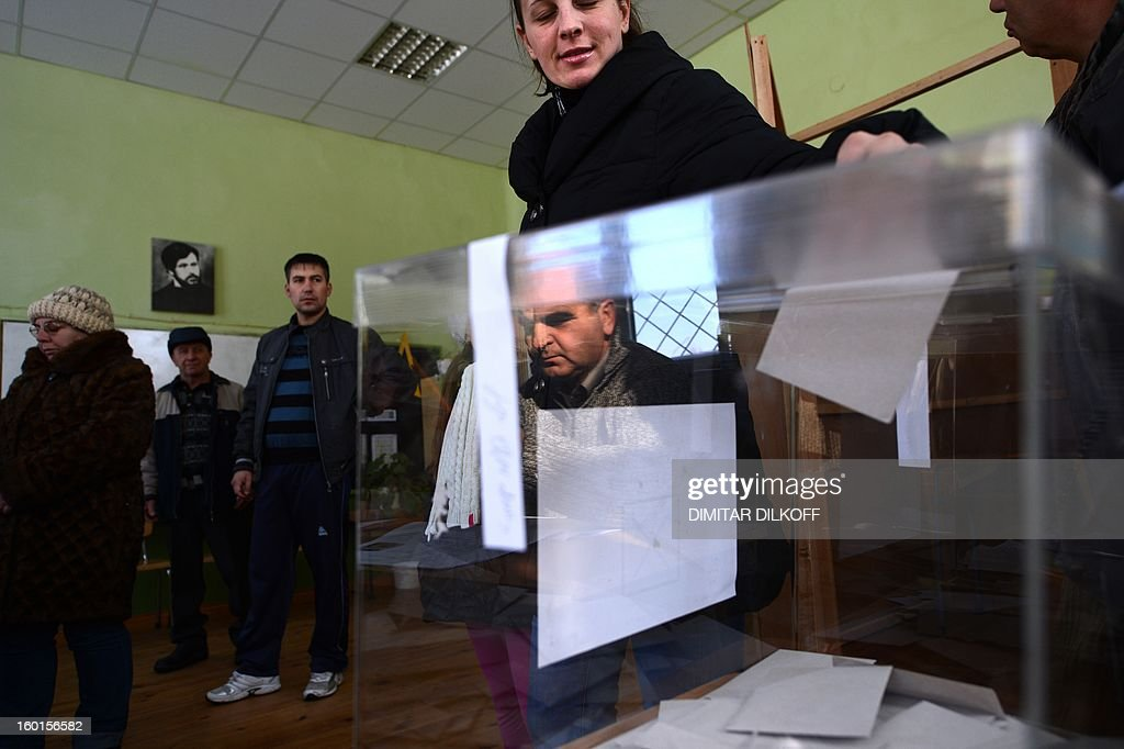 A woman casts her vote during the national referendum in the town of Belene on January 27, 2013. Bulgarians voted Sunday on whether to revive plans ditched by the government to construct a second nuclear power plant, in the EU member's first referendum since communism. The referendum asks 6.9 million eligible voters: 'Should Bulgaria develop nuclear energy by constructing a new nuclear power plant?' AFP PHOTO / DIMITAR DILKOFF
