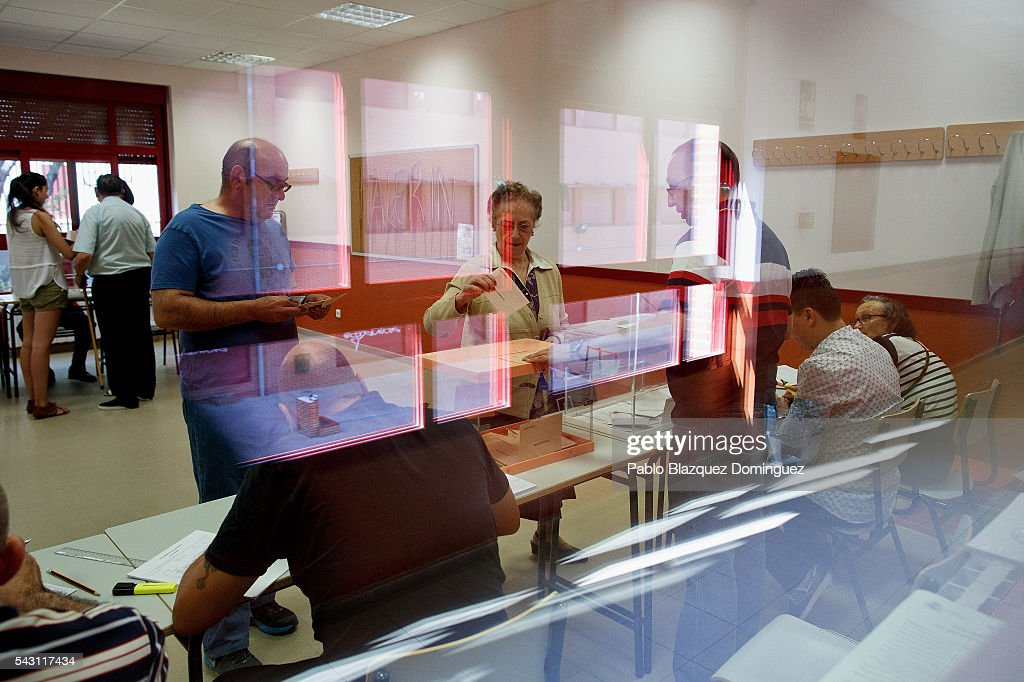 A woman casts her vote during the Spanish General Elections on June 26, 2016 in Madrid, Spain. Spanish voters head back to the polls after the last election in December failed to produce a government. Latest opinion polls suggest the Unidos Podemos left-wing alliance could make enough gains to come in second behind the ruling center right Popular Party.
