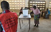 A woman casts her vote for presidential elections at a polling station in Lome on April 25 2015 Togo began voting for a new president with the...