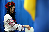 A woman casts her vote in a polling booth on May 25 2014 in Kiev Ukraine The Ukrainian Presidential elections taking place today are widely viewed as...