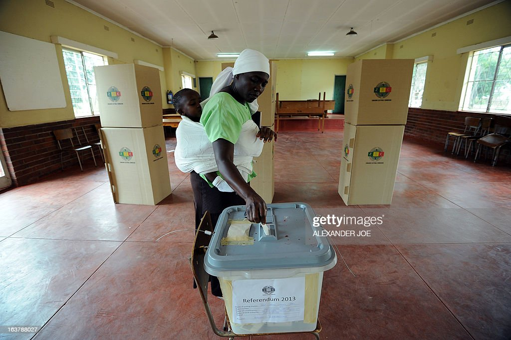 A woman casts her vote in Chitungwizaon March 16, 2013 at a polling station as voting kicked off for Zimbabwe's referendum for a new constitution for the country, to adopt a new charter to pave way for new elections and a possible end to a shaky power-sharing government.
